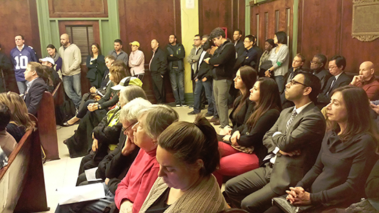 At a packed Hoboken City Council meeting in November 2016, Council voted 8-0 to reject the settlement allowing Shipyard to build additional units in Hoboken elsewhere while giving the city the financial responsibility of developing the park on the pier. Photo courtesy of FBW.